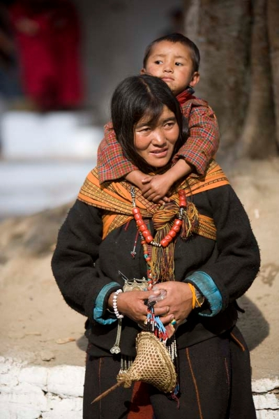 Layap woman carrying her child