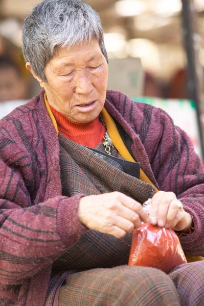 Old woman with red chilli powder