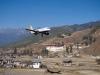 Druk Air plane flying past Paro Dzong
