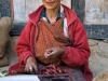 Old woman with red chillies