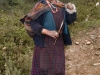 Old woman spinning wool